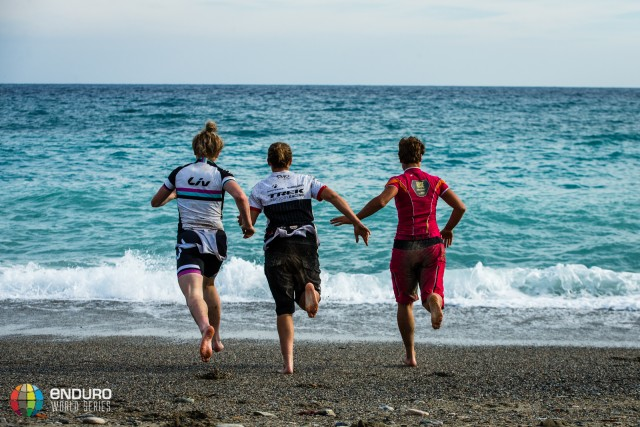 Tracy Moseley celebrates her title with Annie Last and Natalie Schneitter by juping in the sea. EWS round 8, Finale Ligure, Italy. Photo by Matt Wragg.