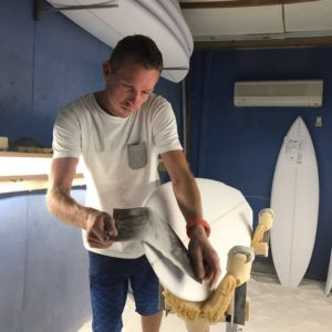 Clayton Neinaber of Clayton Surfboards in the shaping bay