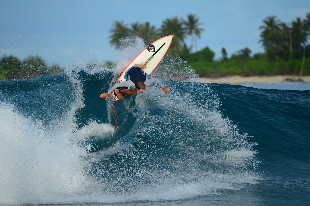 Shaper and surf coach Clayton Neinaber, backhand snap on a Spine-Tek Clayton surfboard at Macaronis, Indonesia