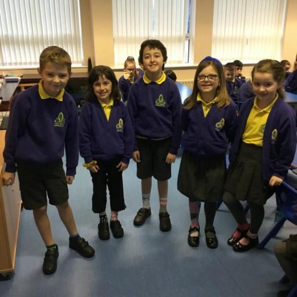Showing off their odd socks in Mr Dooris' P4 class