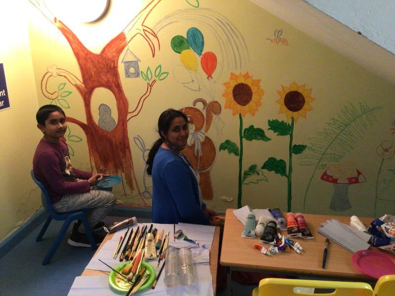 Liji and Arjun painting a beautiful mural in P1