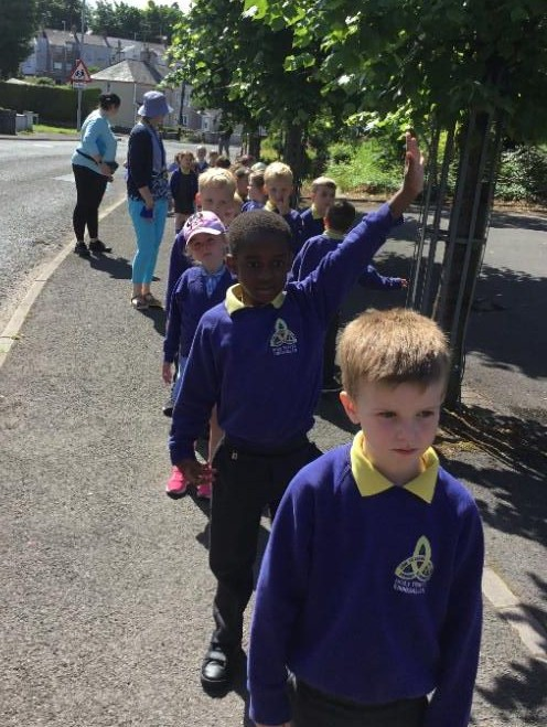 Mrs McCann's P1 class keeping save while out on their sponsored walk