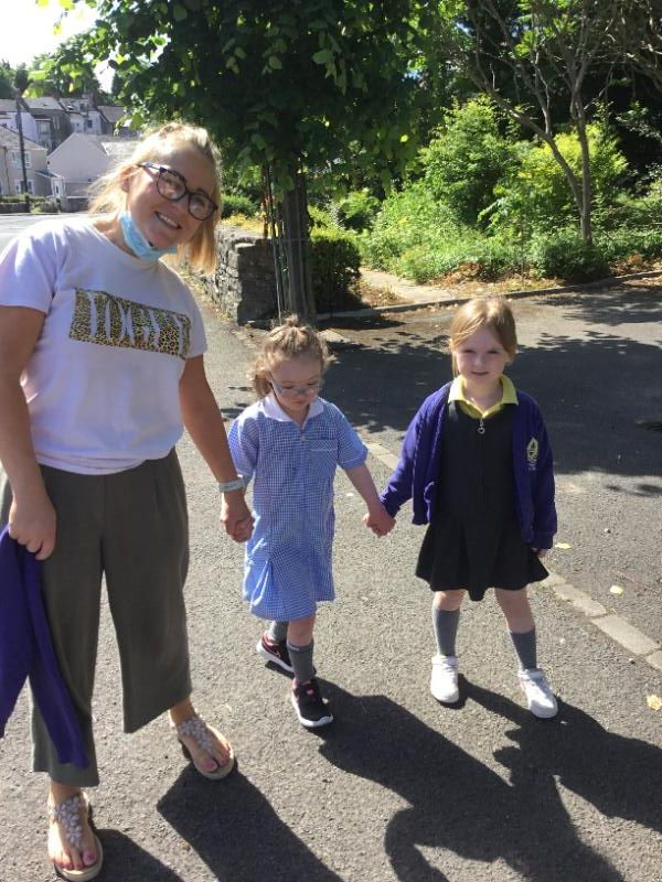Michelle walks with some of our P1 children during their sponsored walk