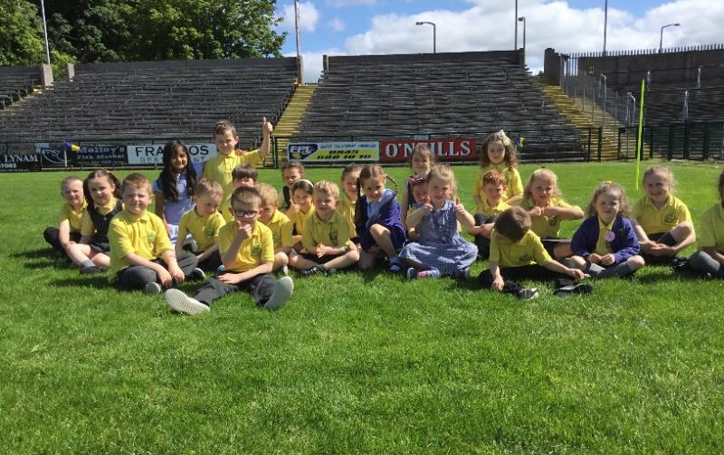Miss Coyles P2 class enjoy a well earned rest at Brewster park during their sponsored walk.