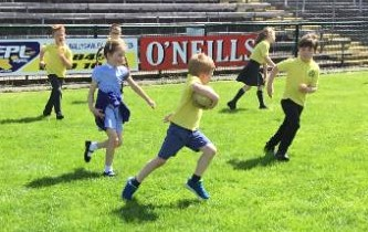 Miss Coyles P2 class enjoy some games at Brewster park during their sponsored walk.