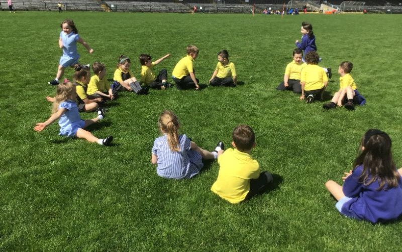 Miss Farley's P2 class enjoy games at Brewster park where they took a break during while out on their sponsored walk.