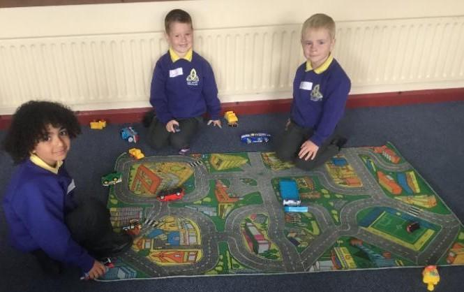 Mrs McMenamin's P1 class: playing on the mat