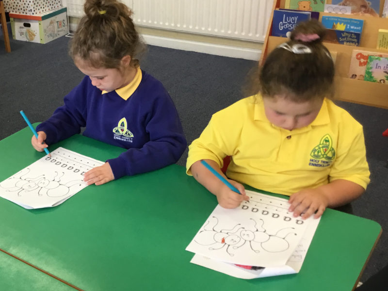 Mrs McCann's P1 Class: practicing forming letters.