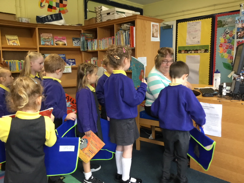 Mrs McCann's P1 Class: getting a book from the Library.