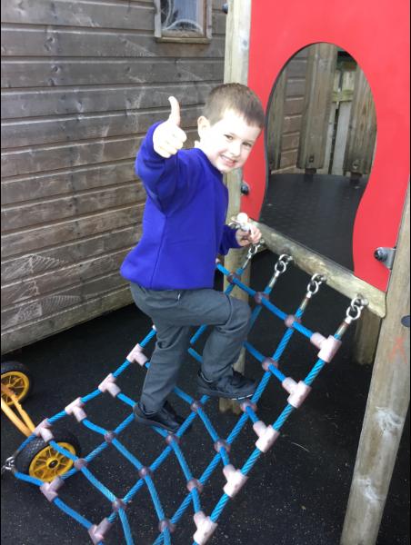Mrs McCann's P1 Class: enjoying the climbing frame.