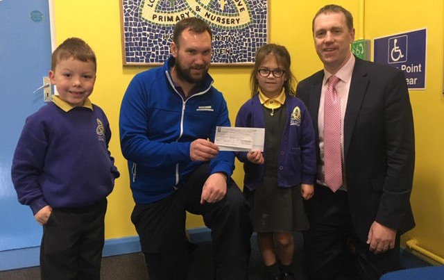 Presentation of a cheque to Mark Burns who is raising money for Mencap.