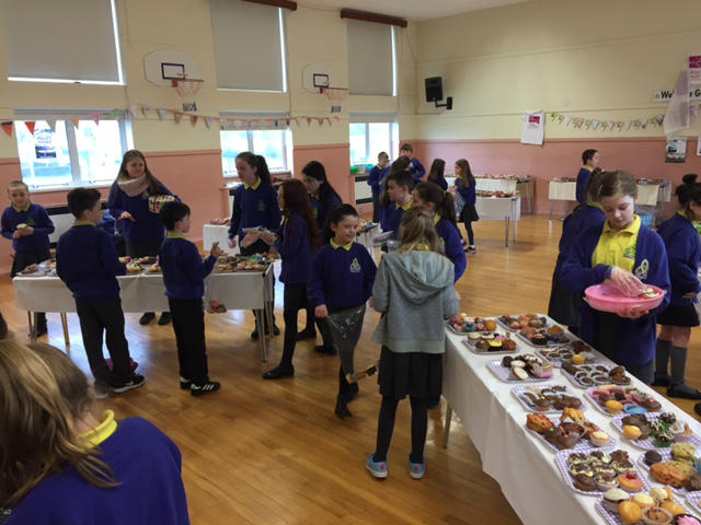 Pupils shop for cakes and buns during the KS2 cake sale
