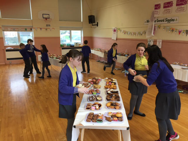Shopping for buns during the Holy Trinity fund raising cake sale.
