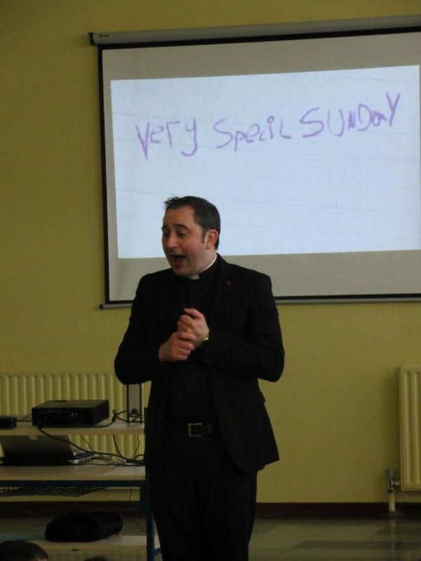 Father Raymond talks to the P1 and P2 children during his Easter assembly