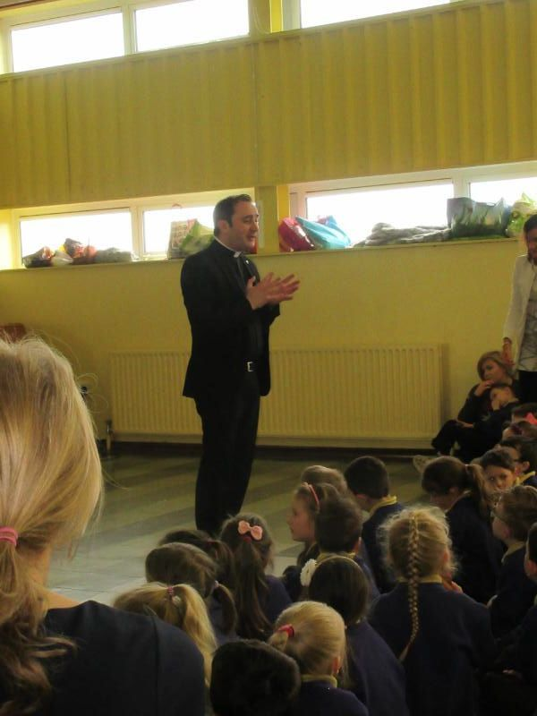 Father Raymond gives a special Easter assembly to the P1 and P2 classes