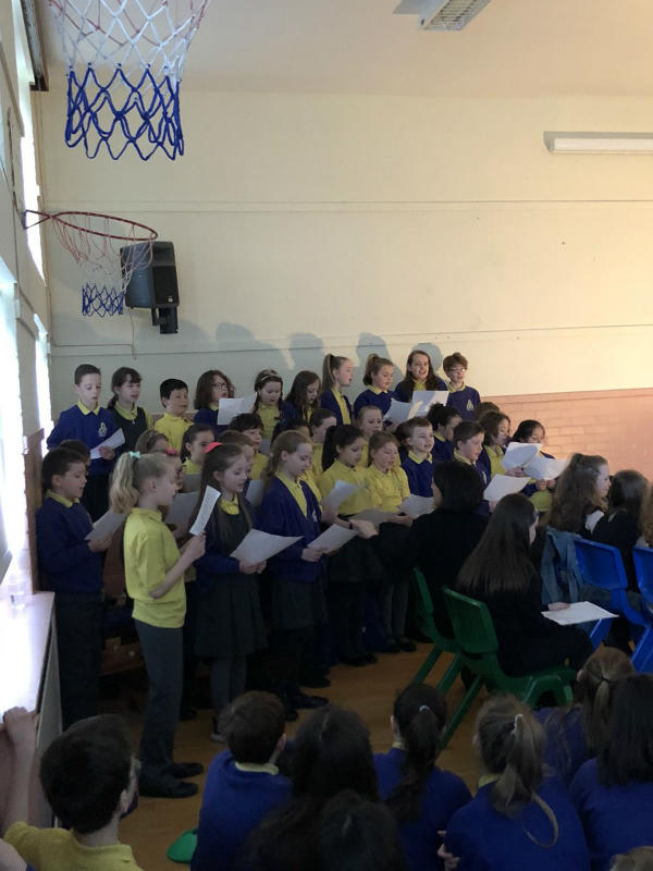The Choir sing during the Stations of the Cross performance