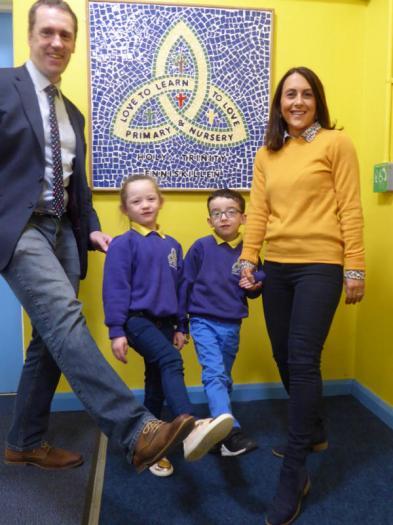 Mr Treacy, Teresa and pupils support Saint Vincent De Paul on 'Jeans for Vincent' day