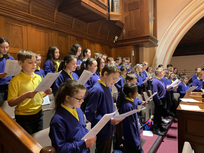 The senior choir sing at First Confessions.