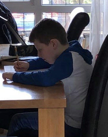Josh working on his homework. keep it up Josh.
