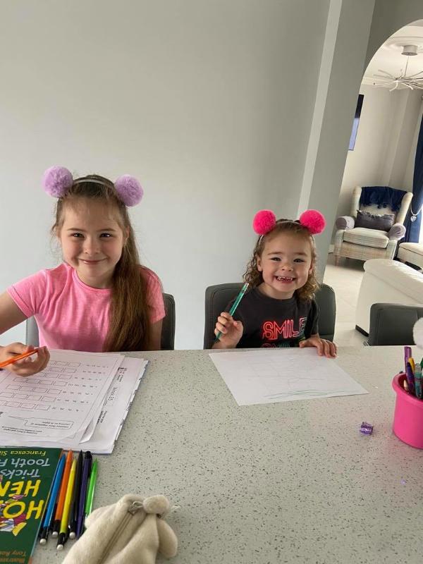 Nicole and Kara doing their homework