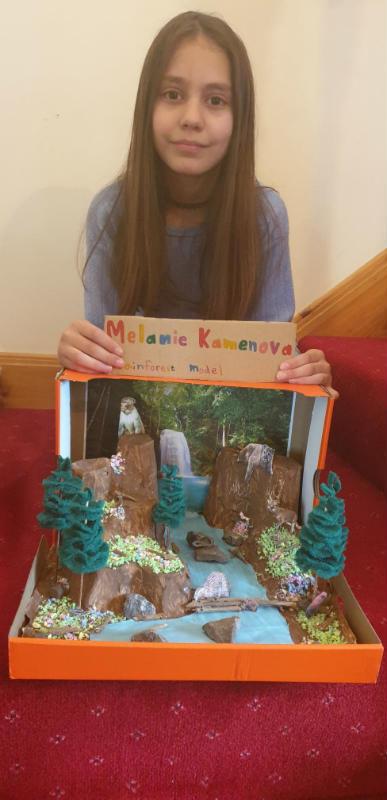 Melanie with her rainforest model