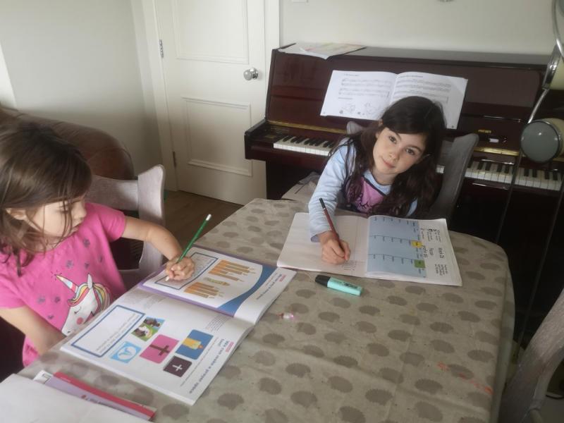 Georgia and Teagan working through their homework packs