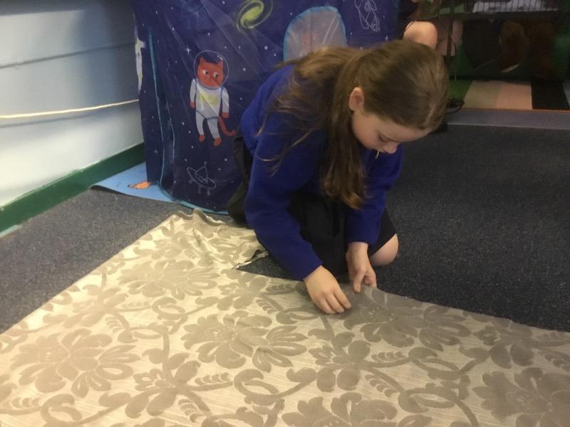 Cutting out fabric to make a Japanese Kimono.