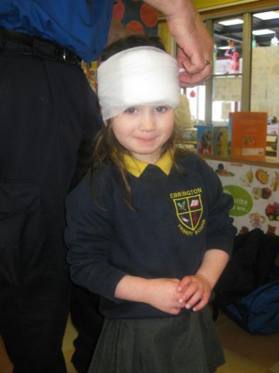 Alex getting a bandage put on her head