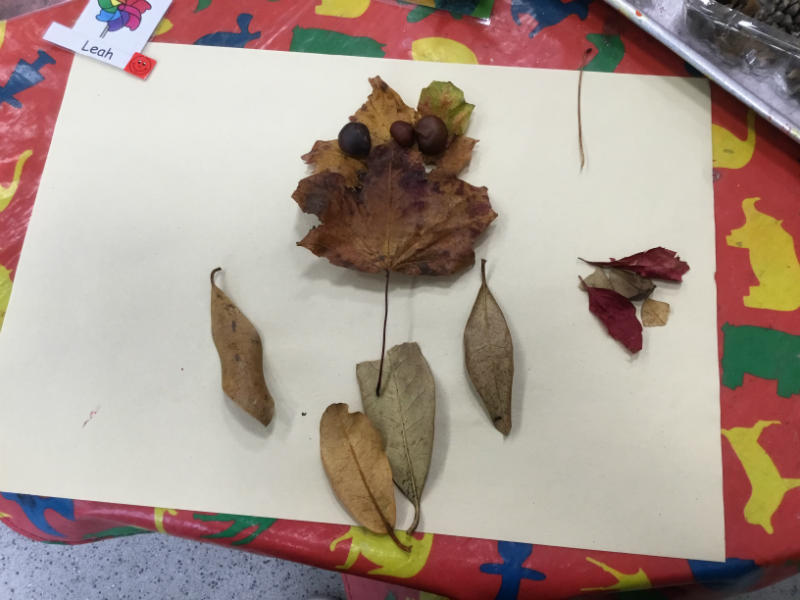 """""""A red and yellow butterfly. Made the eyes and nose, the leaf man."""""""