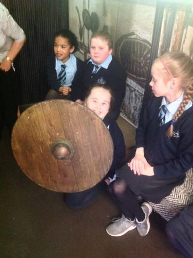 Mia using her shield for protection. We were amazed at how heavy it was.