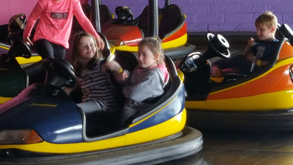Ellie and Jodie having fun on the bumper cars!
