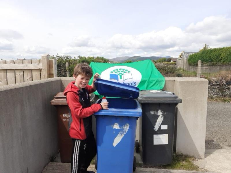 Eoghan - using blue recycling bin at home.