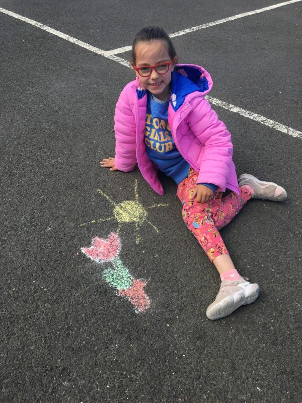 Niamh used chalk to draw a tulip.