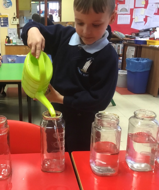 Filling jars with different water levels.