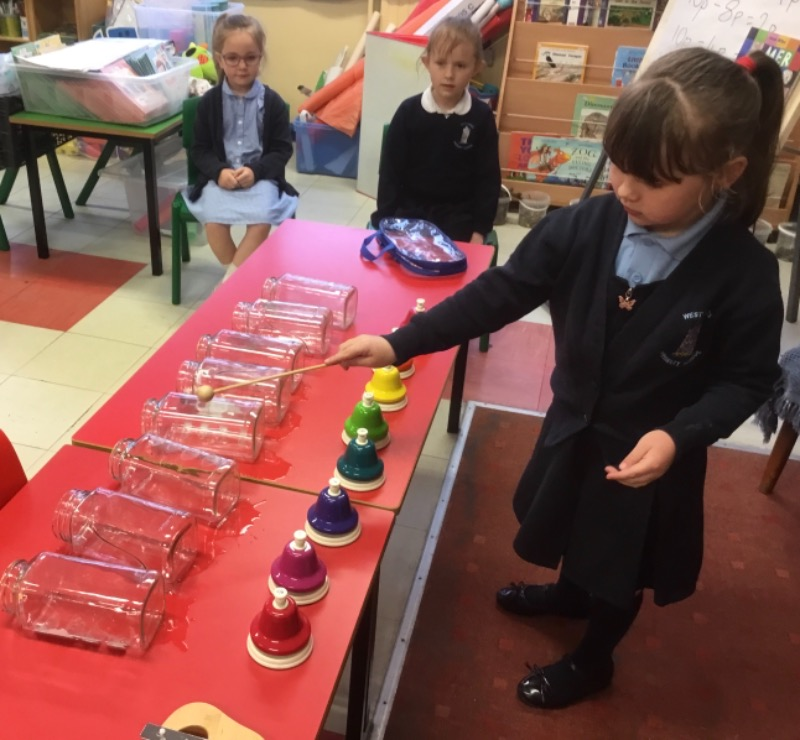 Making sounds with empty jars.