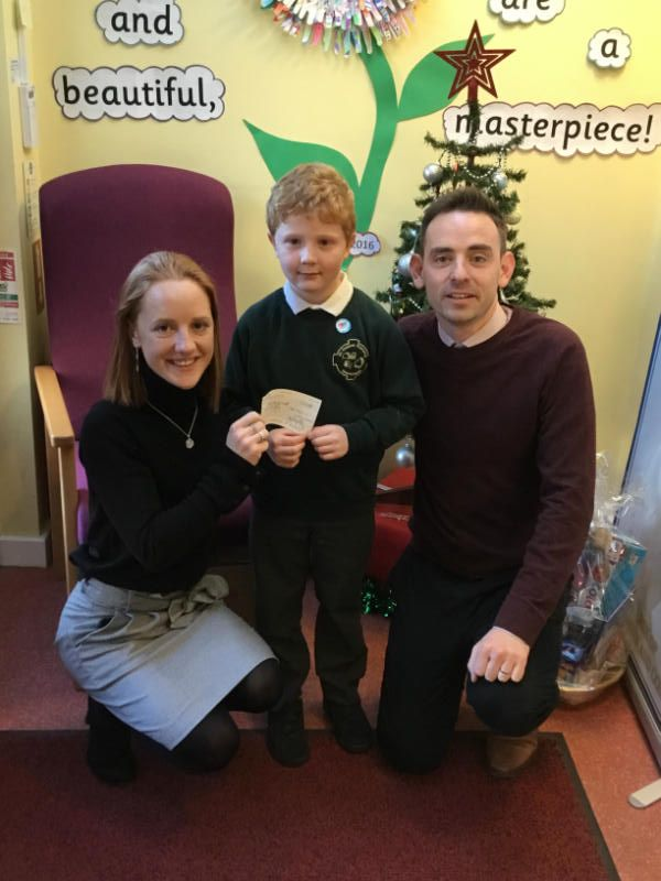 Mr Magee and Darren Og present a cheque to Tanith from Minding Your Head