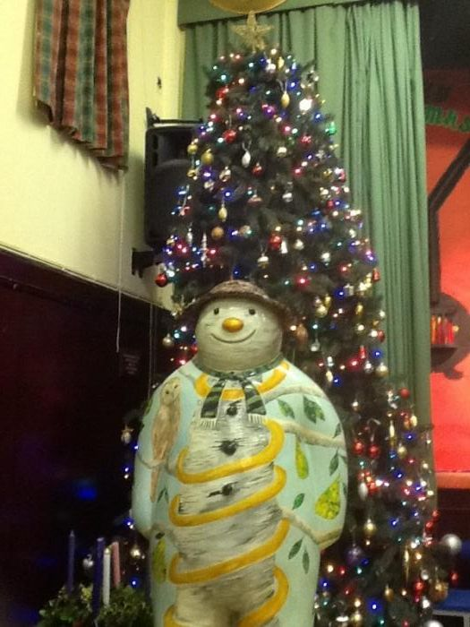 In front of the junior tree - showing a scarf in school colours.