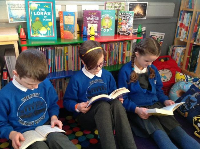 Quietly reading in the library corner