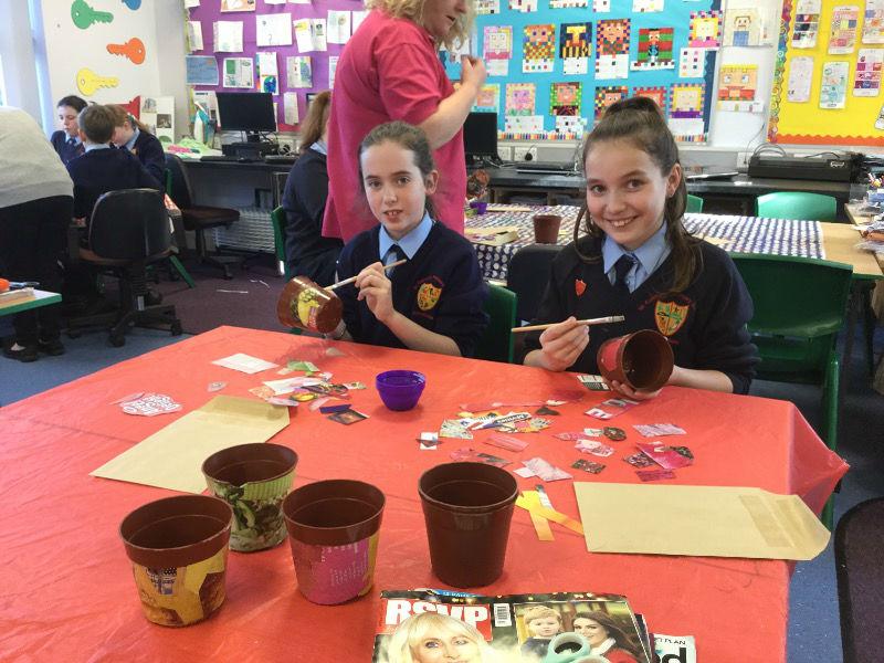 Olivia & Ellie May decoupaging pots