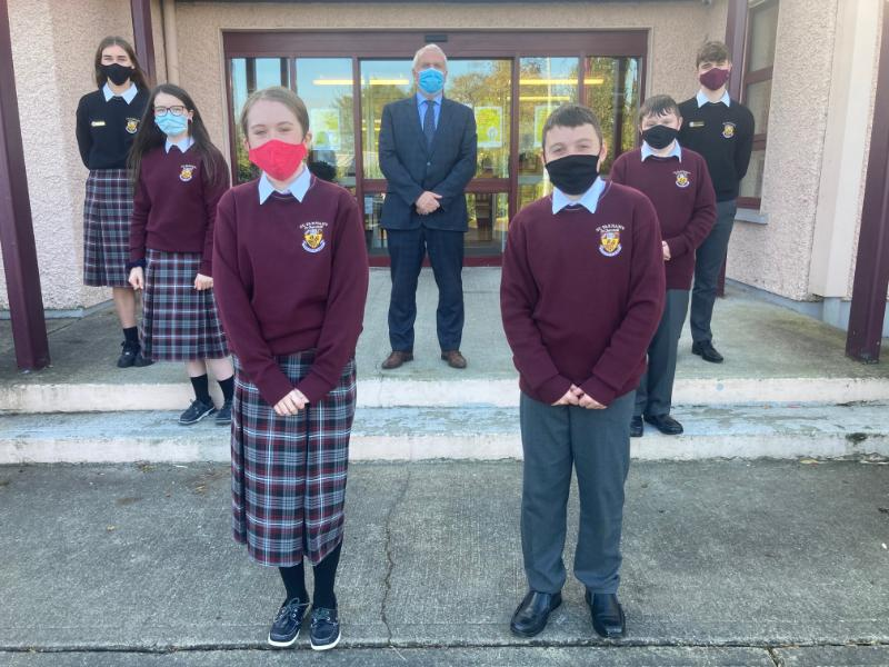 Principal of St. Farnan's Post Primary School, Mr. Eddie Collins with some of our first year students and senior prefects.