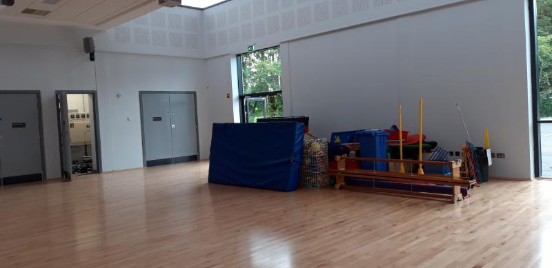 PE equipment is moved into the hall