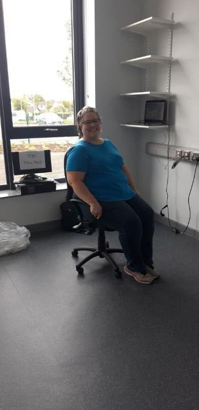 Trying out the new teacher's chair!