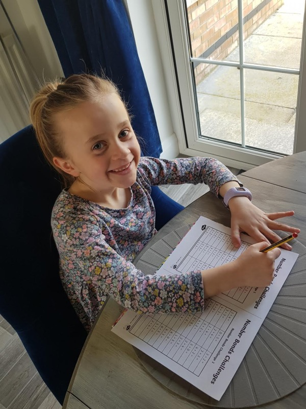 Ava completing her Numeracy ➕➖✔️