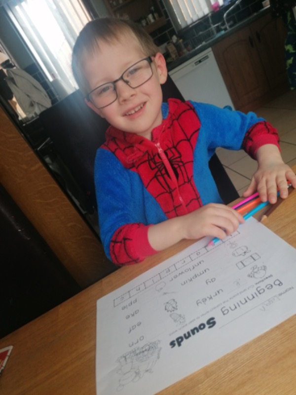Logan completing his work for Miss Donnelly who he is missing very much!