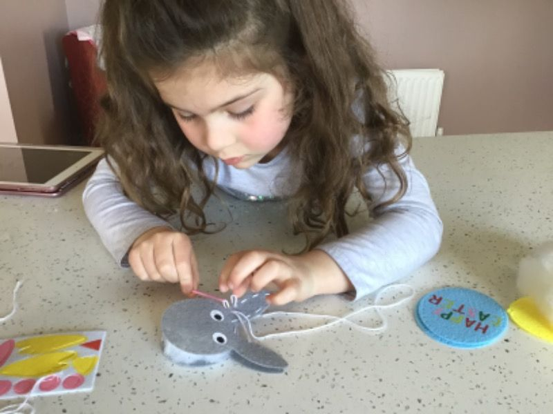 Deirbhile hard at work sewing an Easter 🐣 rabbit 🐰