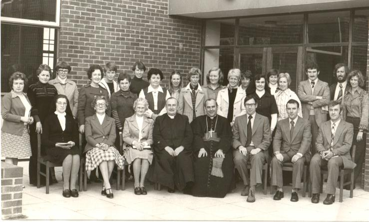 The late Canon Francis McLarnon, Parish Priest and the original staff of St. John the Baptist P.S. photographed with the late Cardinal Tomas O'Fiaich at the blessing and official opening of the school in 1975.