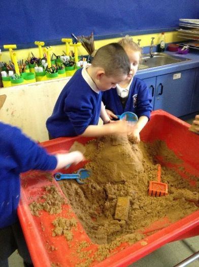 Burying the eggs in the sand. Great teamwork.