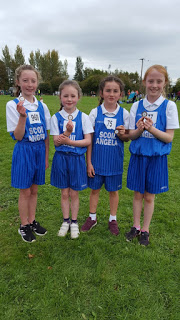 Molly, Alison, Ali and Naoise with their medals.