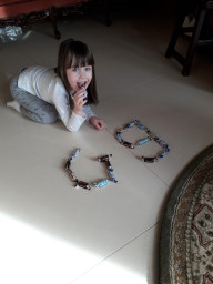 Eliza making the weekly letter.
