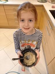 Lillie and her yummy porridge.